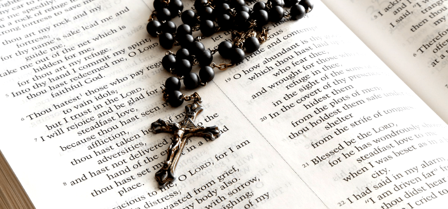 A Rosary on a Bible